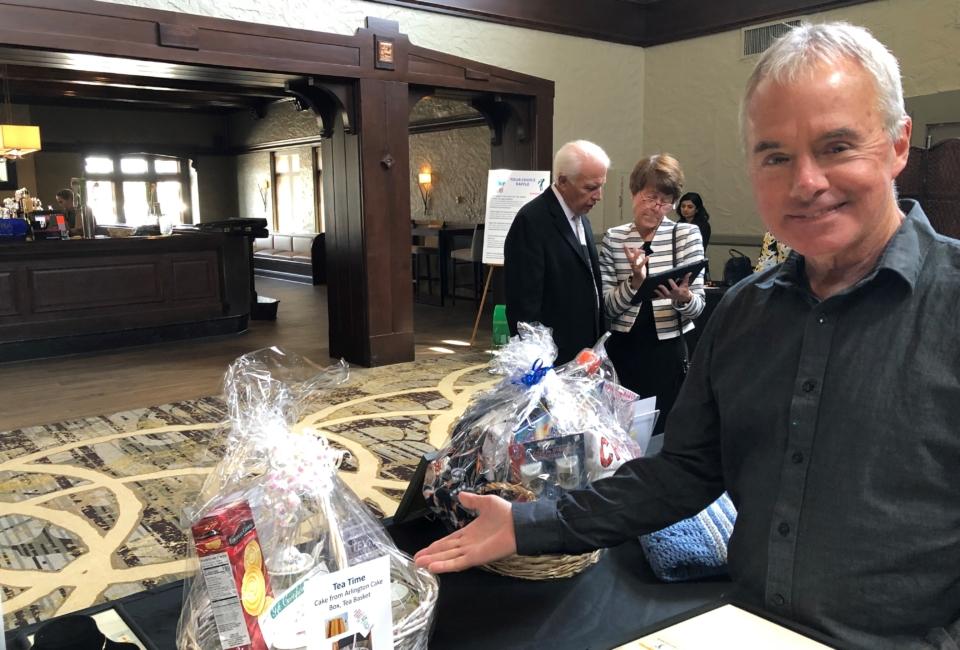Pat Showing Auction Items